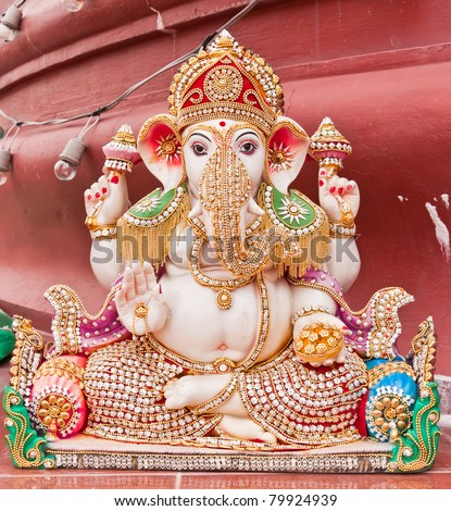 White ganesha statue in sitting action with many decoration - stock photo