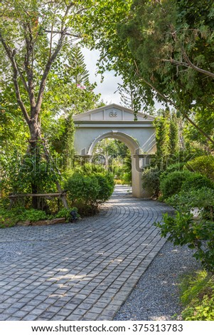 white gate in the garden with garden path in the front