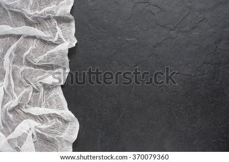 White gauze on the dark stone table - stock photo