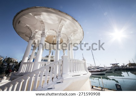 White gazebo with columns, embankment of Sochi - stock photo