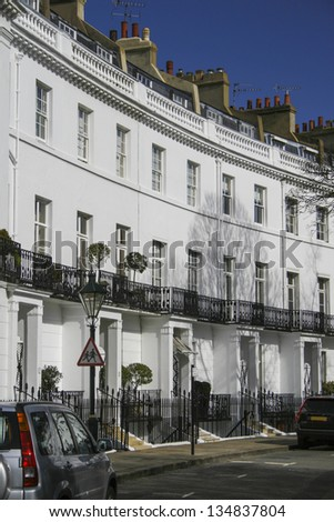 White Georgian architecture on a street in London - stock photo