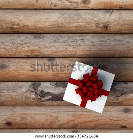 White gift box on a wooden background - stock photo