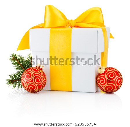 White gift box tied yellow ribbon and two Christmas bauble Isolated on white background