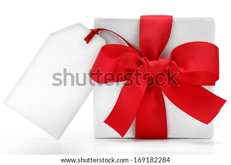 White gift box with red bow and tag