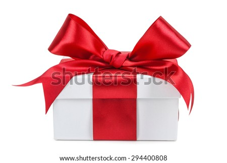 White gift box with red ribbon and bow isolated. - stock photo