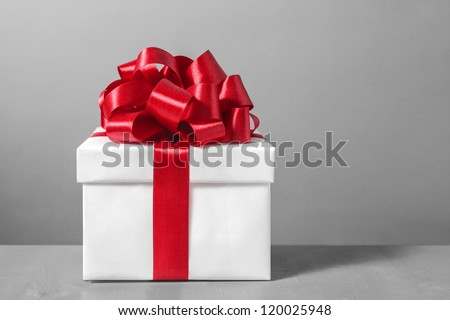 White gift box with red ribbon bow, - stock photo