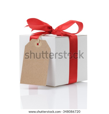 white gift box with red ribbon bow and paper tag, isolated on white background - stock photo