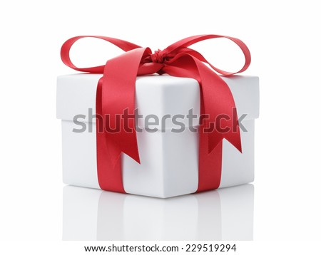 white gift box with red ribbon bow, isolated on white - stock photo