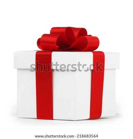 White gift box with red ribbon bow isolated on white background close-up - stock photo