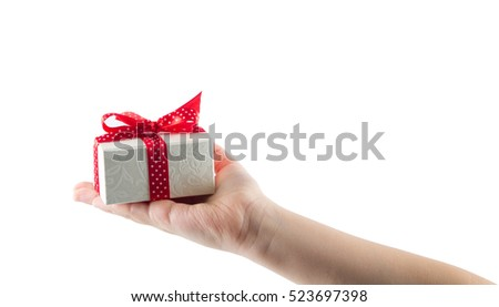 White gift box with red ribbon in hand isolated on white background