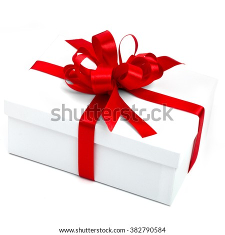 White gift box with red ribbon, isolated on white background.