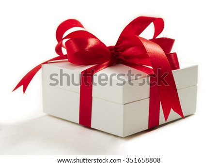 white gift box with red ribbons - stock photo