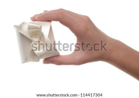 White gift box with ribbon in women hand - stock photo