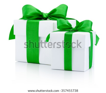 White gift boxes tied green ribbon Isolated on white background - stock photo