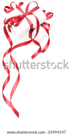 White gift boxes tied with red ribbons.