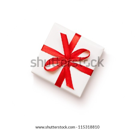 White gift with red ribbon on white background - stock photo