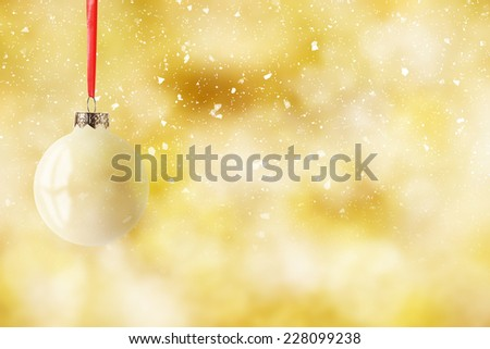 white glass ball on golden space  - stock photo