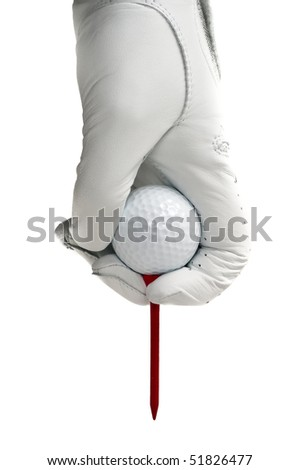 White glove and a white golf ball with a red tee ready to be place in the ground - stock photo