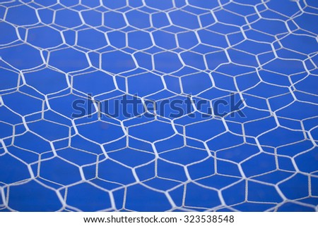 white goal net with blue background - stock photo