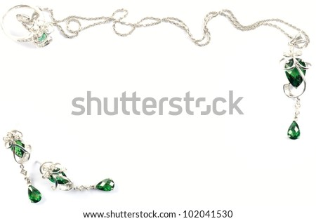 White gold beautiful  set with emerald gems, over white - stock photo