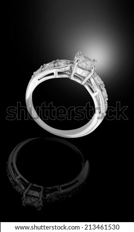 White gold diamond ring on black background