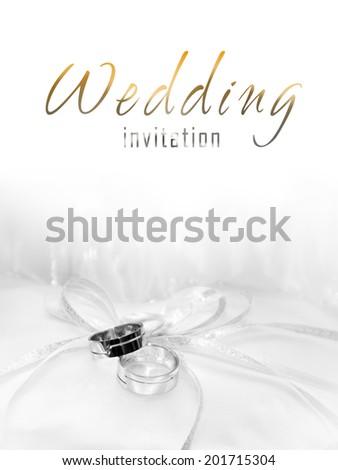 White gold wedding rings invitation - stock photo