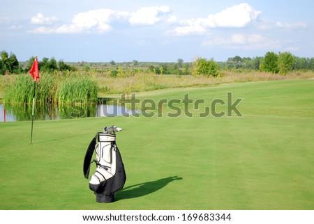 white golf bag on golf course landscape - stock photo