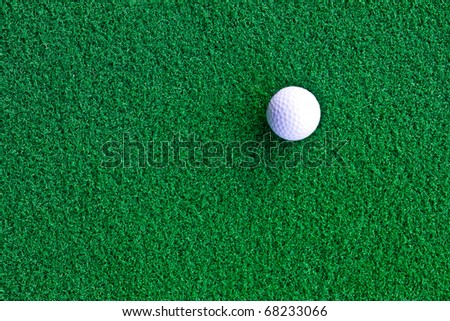 White golf ball on artificial grass - stock photo