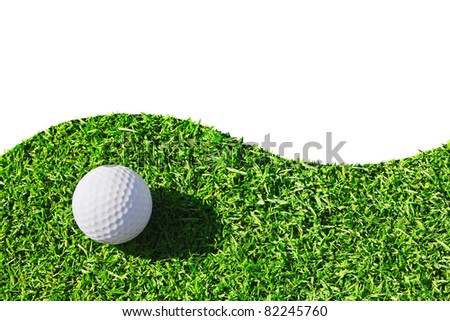 White golf ball on green grass isolated - stock photo