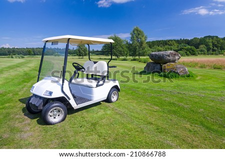 White golf car on Swedish golf course - stock photo