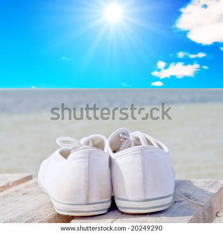 white golf shoes on a wood deck