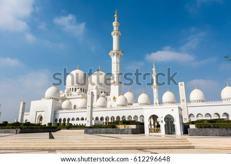 White Grand Mosque built with marble stone against blue sky, also called Sheikh Zayed Grand Mosque in Abu Dhabi, UAE