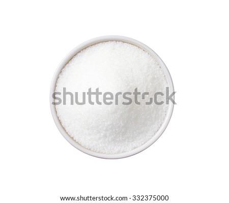 White granulated sugar in ceramic bowl - stock photo