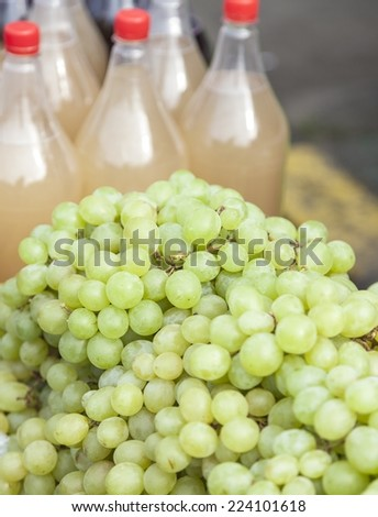 White grapes for sale on the sun light - stock photo