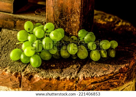 White grapes on rustic brick