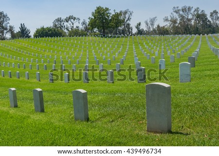 White grave markers of deceased soldiers in Los Angeles National Military Cemetery.