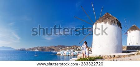 White greek windmills overlooking Little Venice popular tourist destination at traditional village on Mykonos Island, Greece, Europe - stock photo