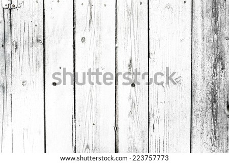 White grey colored old vintage wood with vertical boards. Grunge wooden background. Shabby chic France Provence style