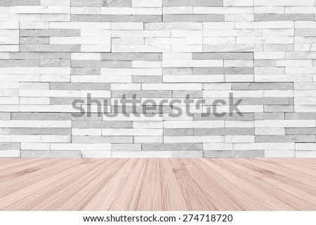 White grey colour brick tile textured wall with wood floor in light red brown color tone for in interiors : Stone tiled wall with wooden table or table top  - stock photo
