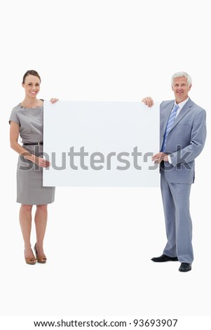 White hair businessman smiling and holding a big white sign with a woman against white background