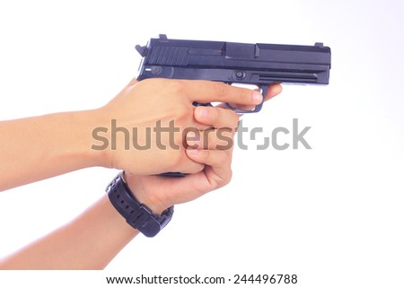 White hand holds gun isolated on white background - stock photo