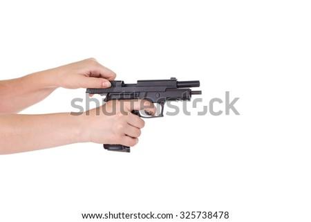 White hand holds gun isolated on white background - stock photo