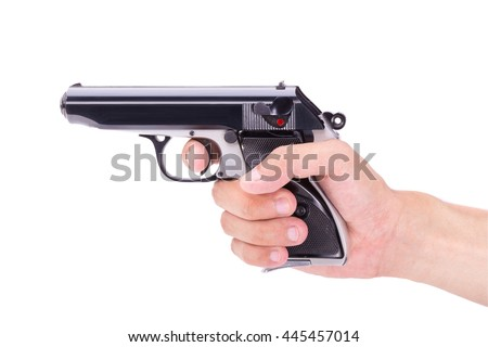 White hand holds gun isolated on white background. - stock photo