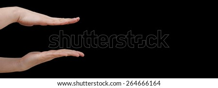 White hand isolated on black background - stock photo