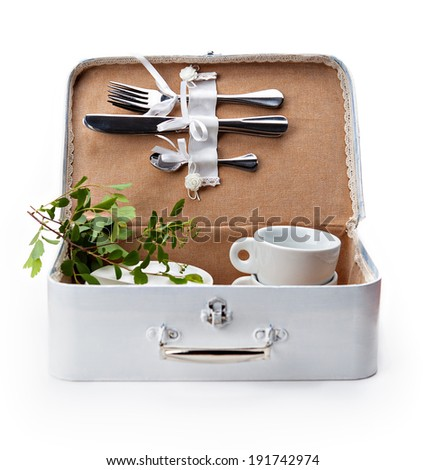 white handmade box for a picnic with tableware on white background - stock photo