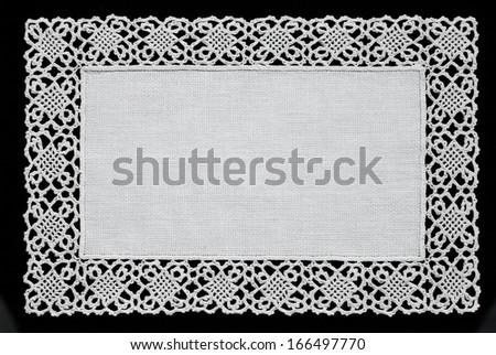 White handmade lace doily  isolated on black background     - stock photo