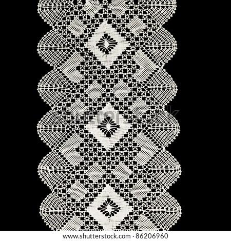 White handmade lace isolated on black - stock photo