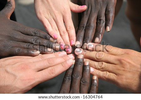 White hands, black hands, pink nails - all together - stock photo