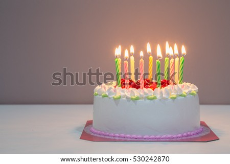 white happy biirthday cake with candles