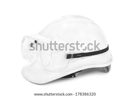 white hard hat and googles on white, small natural shadow under object - stock photo
